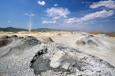 Galandarakhtarma mud volcano. A small whirlwind (dust devil) goes through the field of mud volcanoes.