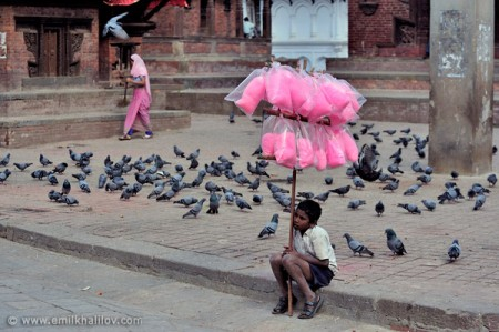 A boy selling cotton candy waits for customers. Durbar Square, Kathmandu.