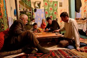 Aliheydar Seyidov and his grandson Sarvar playing backgammon.